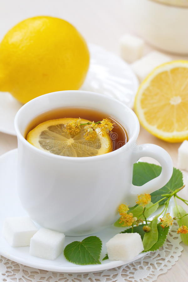 Herbal tea with linden flowers and lemon stock photography