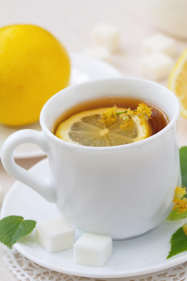 Herbal tea with linden flowers and lemon stock photo