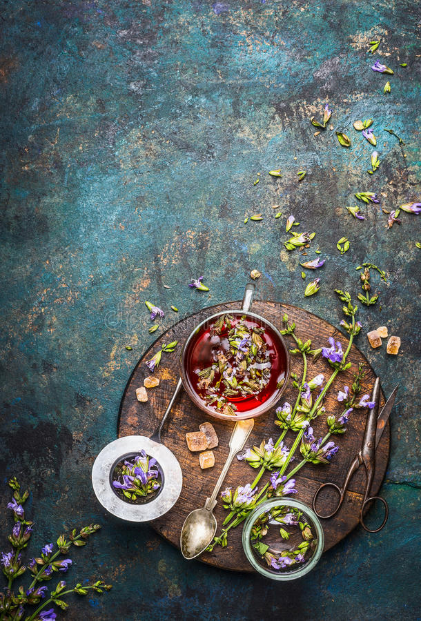 Free Herbal Tea Preparation With Fresh Healing Herbs And Flowers On Dark Rustic Background Stock Images - 75402784
