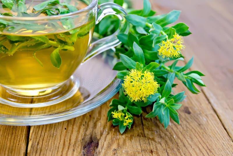 Herbal tea and Rhodiola rosea on board royalty free stock photos