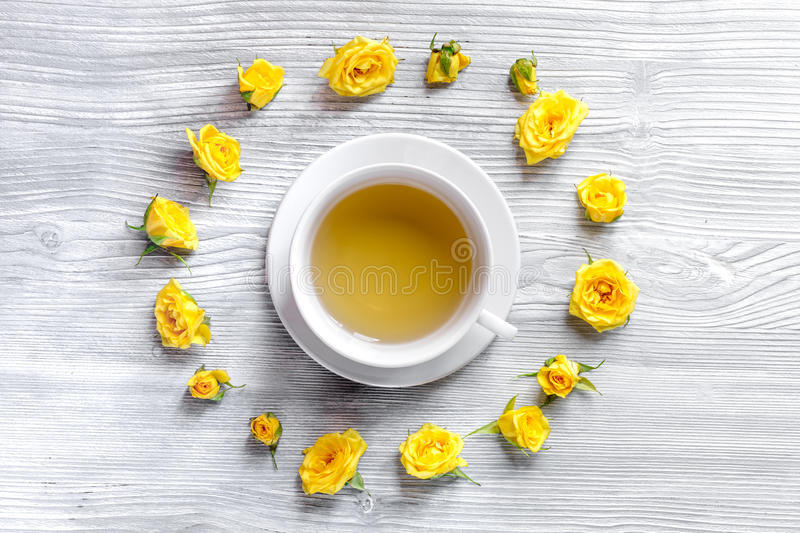 Herbal tea with yellow flowers on wooden table background top view royalty free stock photos