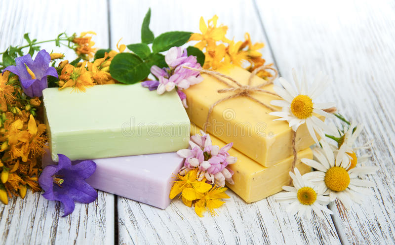 Herbal treatment - camomile, tutsan and soap stock photo