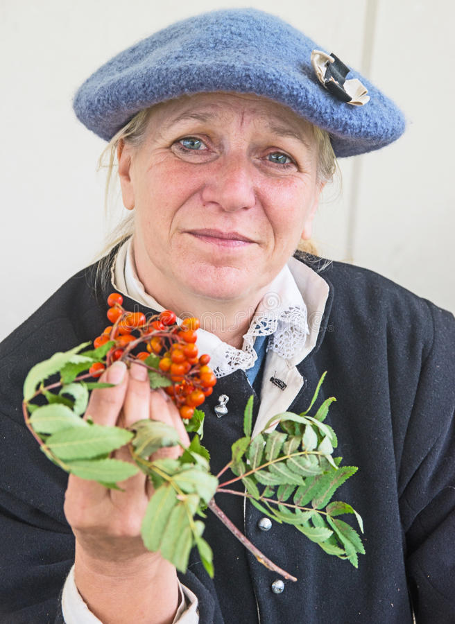 Herbalist at Fort George. `Amazing Ages` performance at Fort George on 13th August 2017 with portrait of a herbalist holding Mountain Ash berries. Jacobite royalty free stock photos