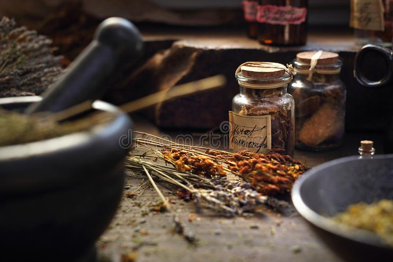 Herbalist. Herbal medicine and natural medicine. Traditional herbal remedies. A composition of herbs, flowers and spices. Healthful potions and infusions on a royalty free stock image