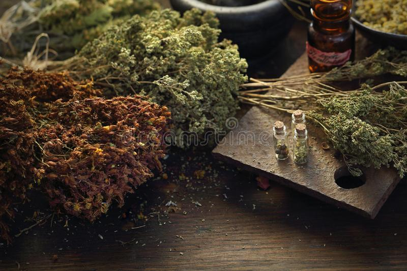 Herbalist. Herbal medicine and natural medicine. Traditional herbal remedies. A composition of herbs, flowers and spices. Healthful potions and infusions on a stock photography