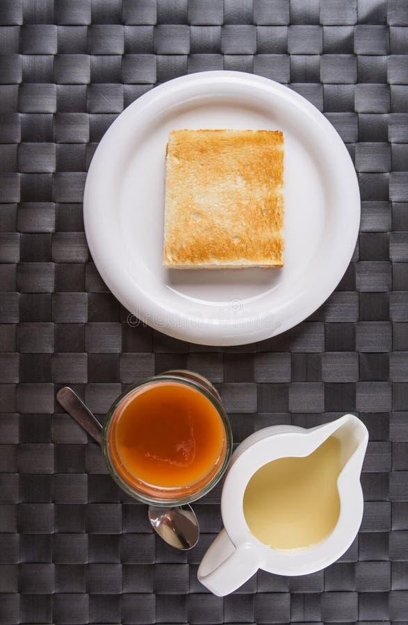 Herbata, grzanka i Kondensujący mleko, Ja obraz royalty free