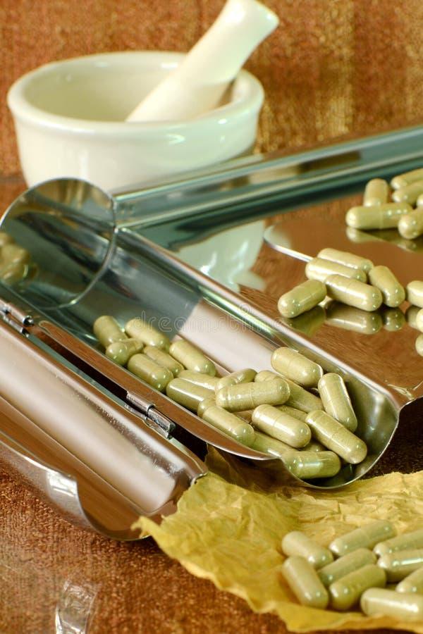 Herbs in capsules. stock photos