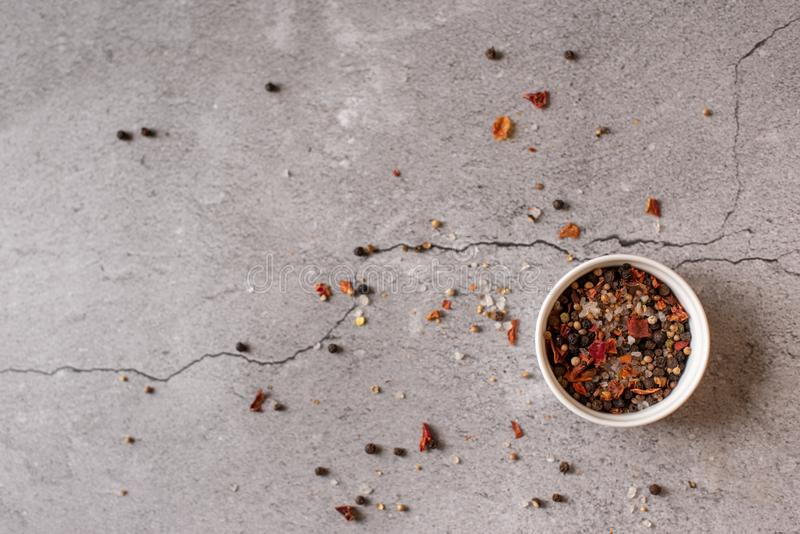 Herbs and condiments on black stone table. Rosemary, basil, thyme and garlic. Top view with copy space.  stock photos