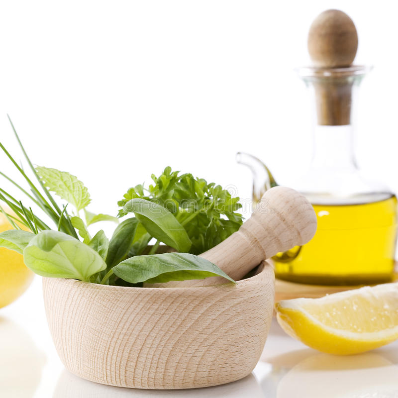 Herbs, lemon and olive oil stock photos
