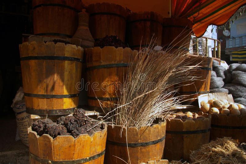 Herbs on the market. Beautifully wooden handmade pots full of aromatic spices on the marketplace. Powders, herbs and dried fruits stock photo