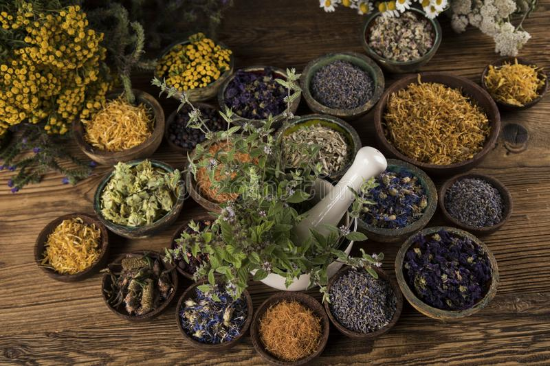 Herbs medicine and vintage wooden background stock photography