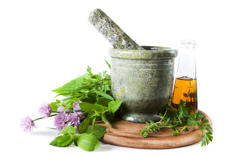 Herbs with mortar stock photos