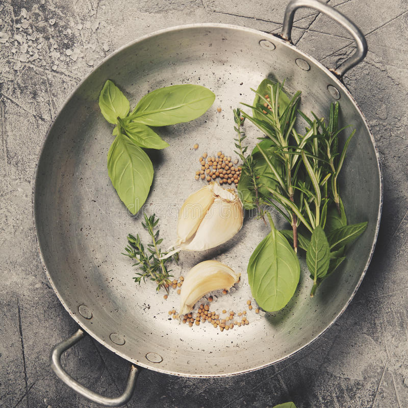 Herbs and spices. On concrete background - top view, copyspace - healthy eating or cooking concept royalty free stock image
