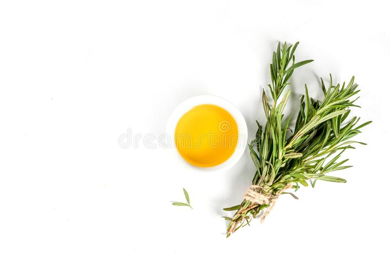 Rosemary and olive oil. Herbs and spices. Rosemary and olive oil on white background, top view copy space isolation royalty free stock photo