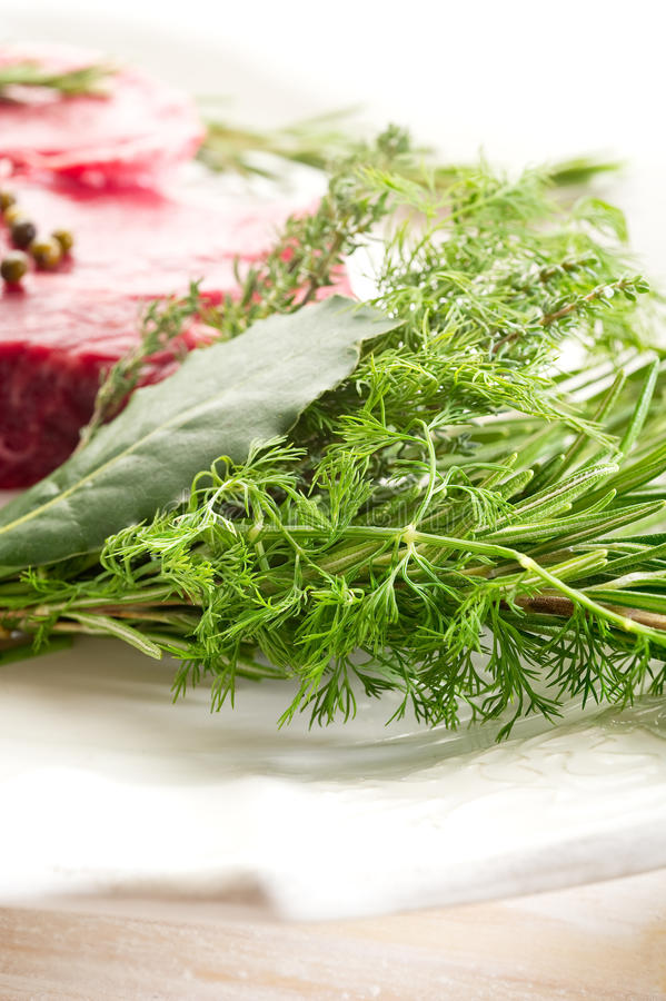 Herbs with tenderloin royalty free stock photography