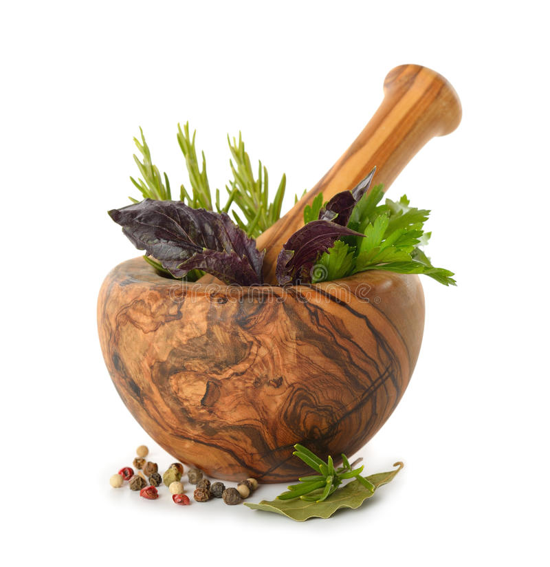 Herbs in wooden mortar stock images