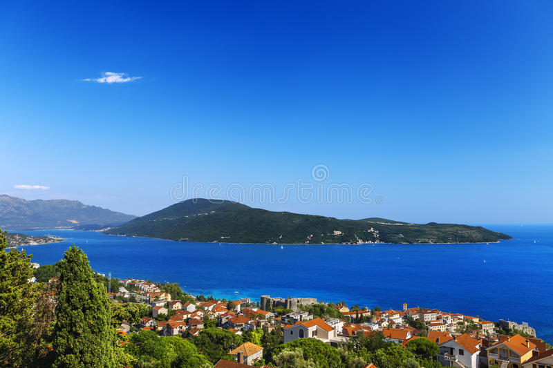 Herceg Novi and Boka Kotorska. Montenegro. Herceg Novi - general view from Spanjola fortress; seen the Old Town with fortresses Kanli Kula and Forte Mare on royalty free stock photos