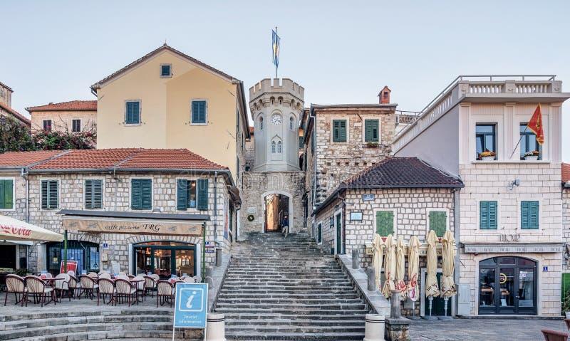 Old gates of the city and the Sakhat Kula tower with the clock. Herceg Novi, Montenegro- November 1, 2016: Old gates of the city and the Sakhat Kula tower with stock photography
