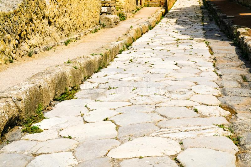 Herculaneum, ancient Roman town. Ancient road paved with stone, Ercolano, Italy. Herculaneum, ancient Roman town. Ancient road paved with stone, Ercolano Italy stock photography