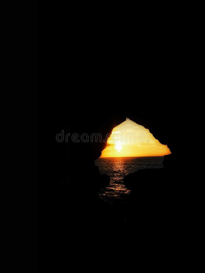 The  hercules caves  in tanger morocco. Are the oldest cave in africa afriqe asilah asilahbeach asilh beautifl brown city coast cost cow diversity door farm stock photography