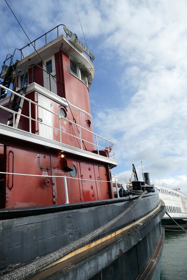 Cargo Ship Engine Room: Maritime Tugboat Pulling A Cargo Ship On A Canal Stock