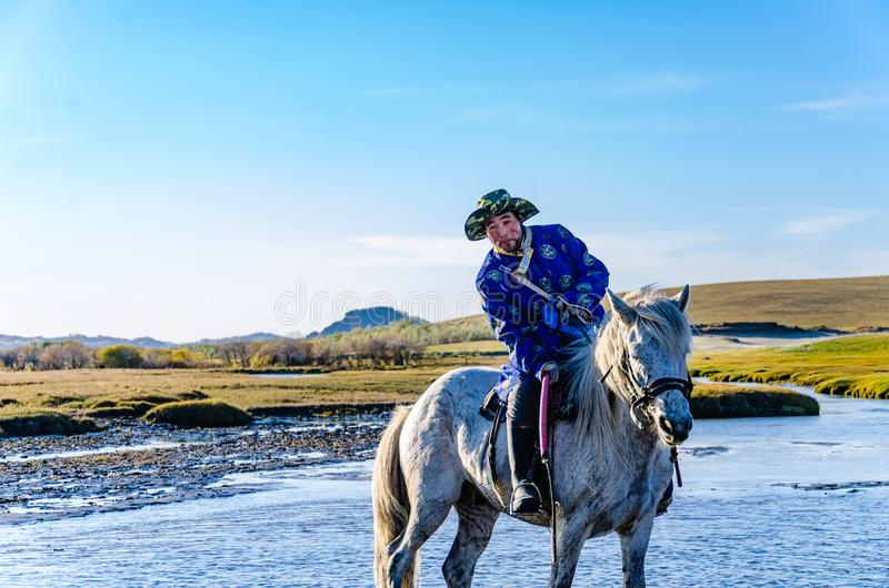Herdsman running in the river on the horse royalty free stock photos