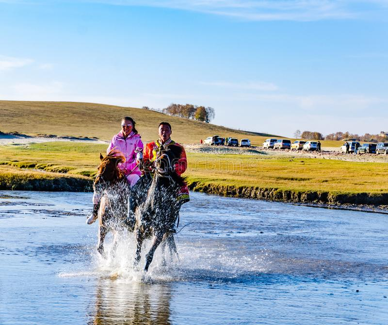 Herdsman running in the river on the horse royalty free stock photo
