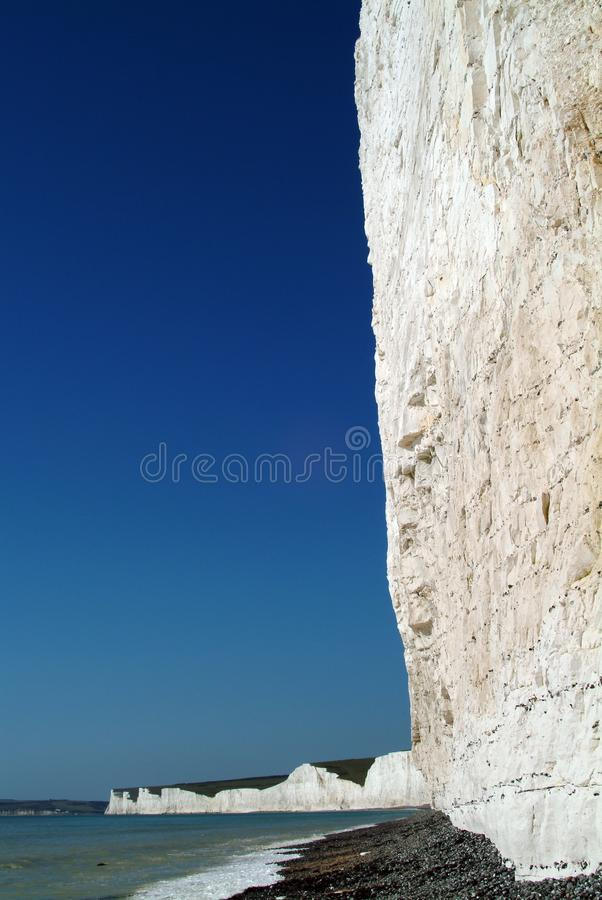 The huge chalk cliff at Birling Gap in East Sussex, west of Eastbourne, England. Here at Birling Gap, the sea is cutting away at the base of the giant chalk royalty free stock photo