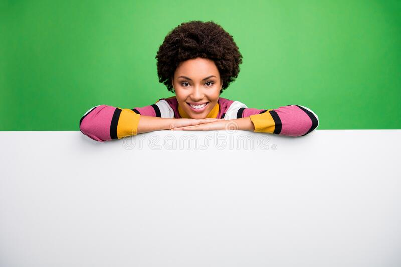 Here can be your advertisement. Photo of funny dark skin lady presenting big white empty space paper poster for news. Here can be your advertisement. Photo of stock photos