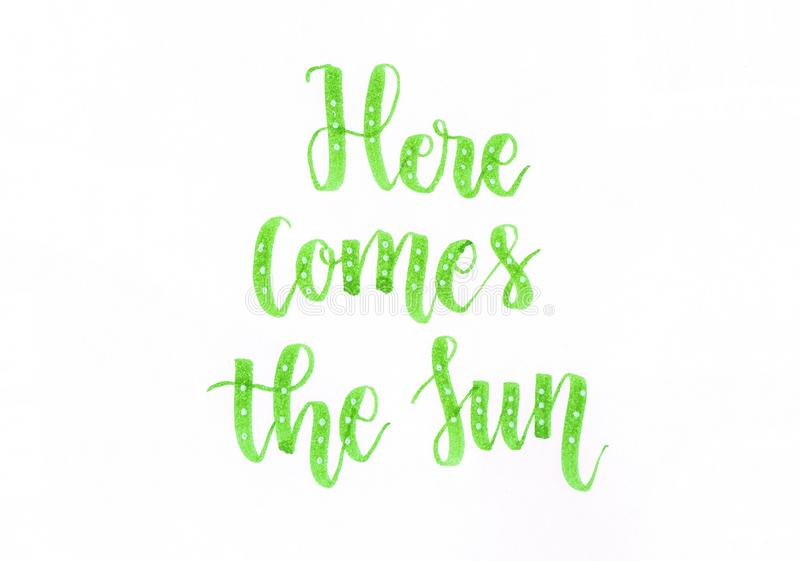 Here comes the Sun - green hand lettering inscription in green with white dots stock illustration
