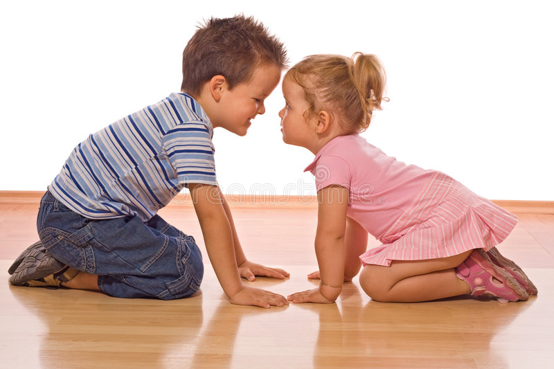 Here is the deal sis. Little boy doing some convincing or explaining on her little sister - isolated stock photo