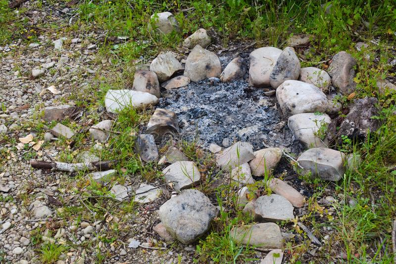 Extinguished bonfire. Extinguished fire in the wood, ashes stock photography