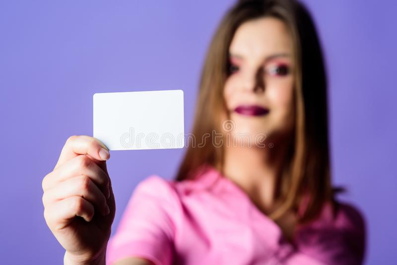 Here is my business card. nurse in white uniform hold business card. sexy woman doctor. health care and medical concept stock image