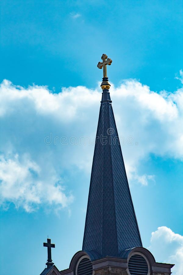 Crosses in the sky. Here are two crosses on top of a church royalty free stock photos
