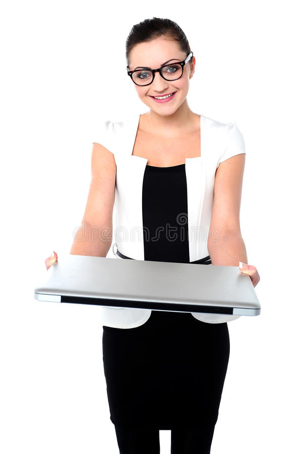 Here is your brand new laptop. Corporate lady showing laptop to camera royalty free stock photos
