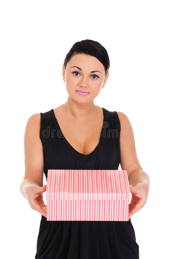 Here is your present, darling. Young lady in evening dress presenting boxed gift royalty free stock image