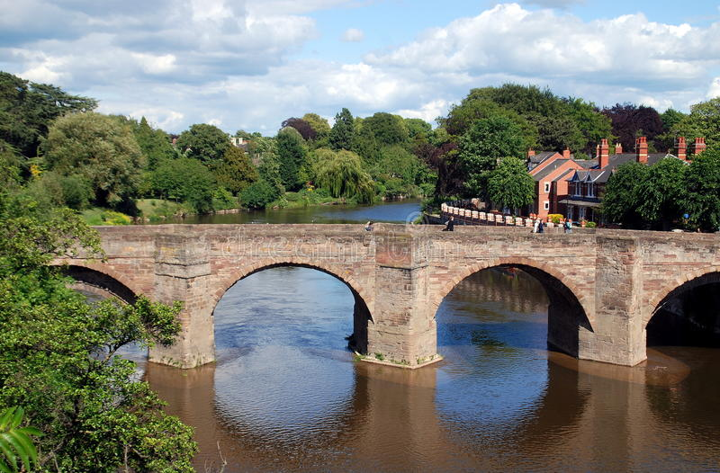 Hereford, England: River Wye Medieval Bridge. A medieval stone bridge with four arches spans the tranquil River Wye in a pastorale, buccolic setting in Hereford stock images