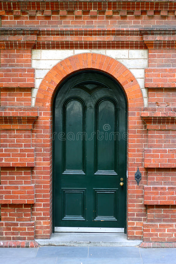 Heritage Arched Door in Red Brick Wall royalty free stock images