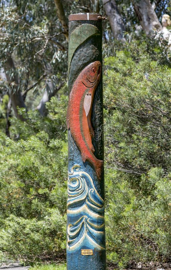 Heritage Bush Poles in Waroona. In the town centre are heritage bush poles The carvings include a Kangaroo, Trout, Crab, Marron, Drake, Dairy Cow, Red-tailed royalty free stock photography