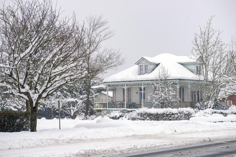 Heritage home during a winter storm in Vancouver Island, Canada royalty free stock image