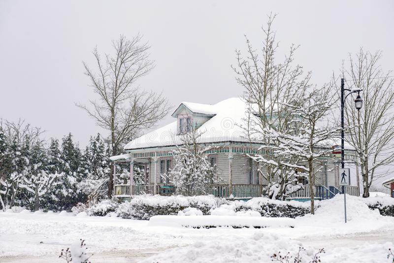Heritage home during a winter storm in Vancouver Island, Canada. Heritage home during a winter storm in the town of Ladysmith in Vancouver Island, Canada stock photography