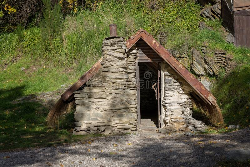 A Heritage Listed Hut Constructed In 1860`s In Arrowtown New Zealand royalty free stock photo