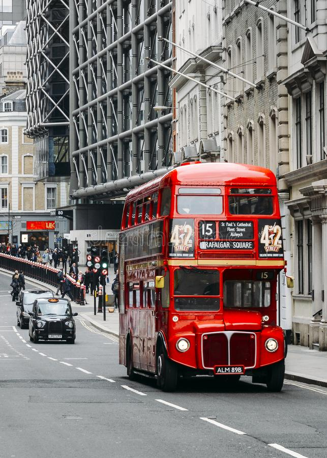 Heritage red Routemaster Bus operating in the City of London. Open platform at back facilitated speedy boarding under. London, UK- Mar 13, 2018: Heritage red stock image