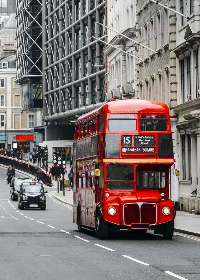 Heritage Routemaster Bus operating in a busy Central London street with traditional black cab on background.  stock photography