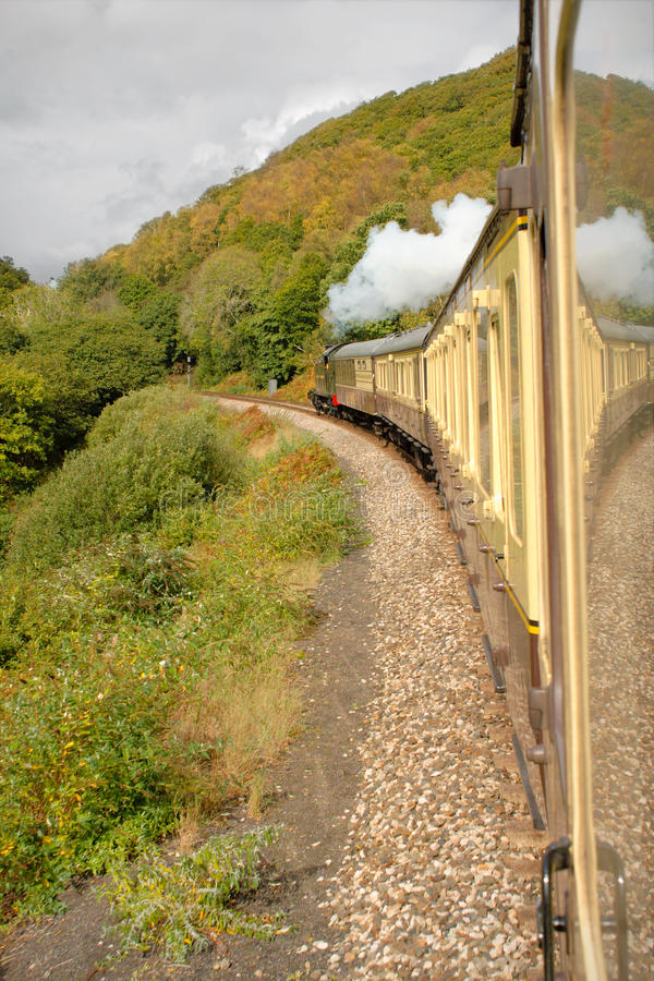 Heritage Steam Train Devon England. The locomotive and carriages of a vintage heritage steam train, viewed from a carriage window. Paignton Steam Railway. Devon royalty free stock photography