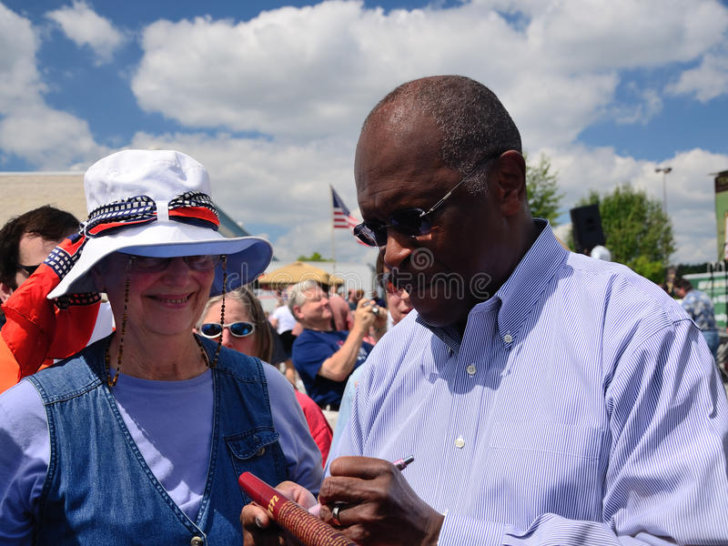 Herman Cain Signs Autograph royalty-vrije stock foto's