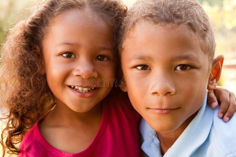 Hermano y hermana de la raza mixta imágenes de archivo libres de regalías