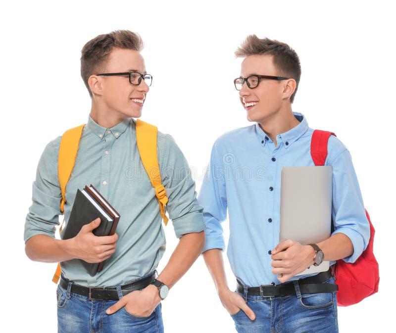 Hermanos gemelos adolescentes con los vidrios en blanco imágenes de archivo libres de regalías