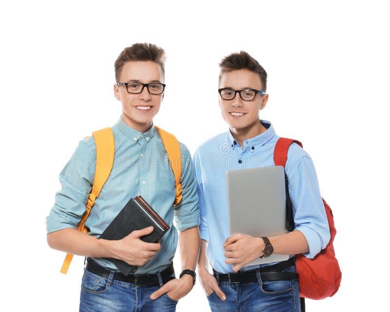 Hermanos gemelos adolescentes con los vidrios en blanco fotografía de archivo