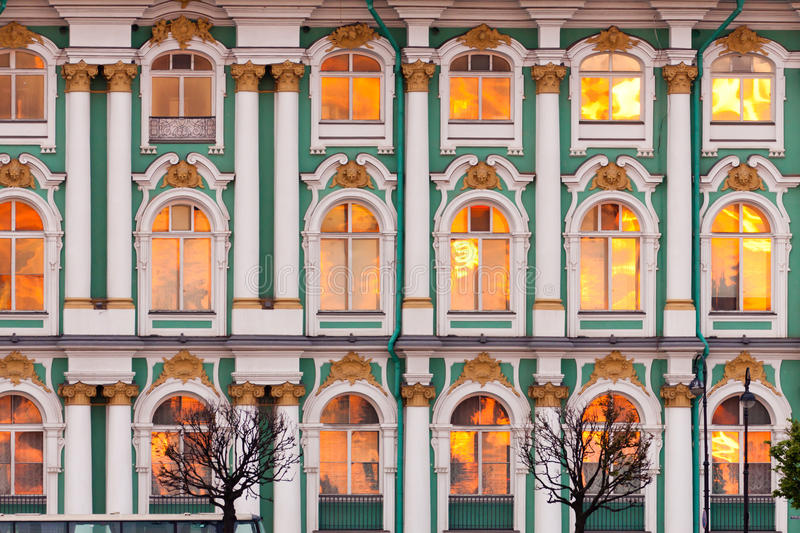 Hermitage. The windows of the Hermitage reflect the sun at sunset royalty free stock photos